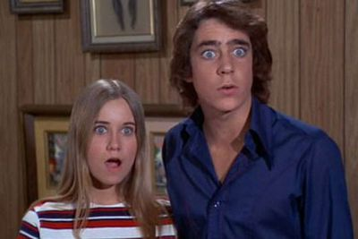 She had a fling with her co-star Barry Williams (who played her step-brother in the show). Their first kiss happened during a Hawaiian holiday special in 1972.<br/><br/>Image: <i>The Brady Bunch</i> / ABC