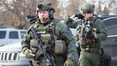 Heavily armed police arrive on the scene of the shooting. Picture: Getty