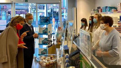 King and Queen of Belgium visit pharmacy to see effect of COVID