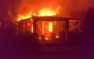 Arson investigation underway as fire engulfs home at Rothwell