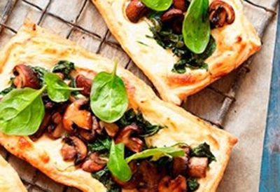 Mushroom and spinach tarts with tomato salad