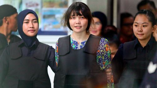 Vietnamese Doan Thi Huong, center, is escorted by police. (AP)