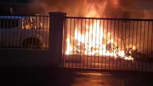 Witnesses captured the ignited plane which narrowly avoided homes in the residential street. (9NEWS)
