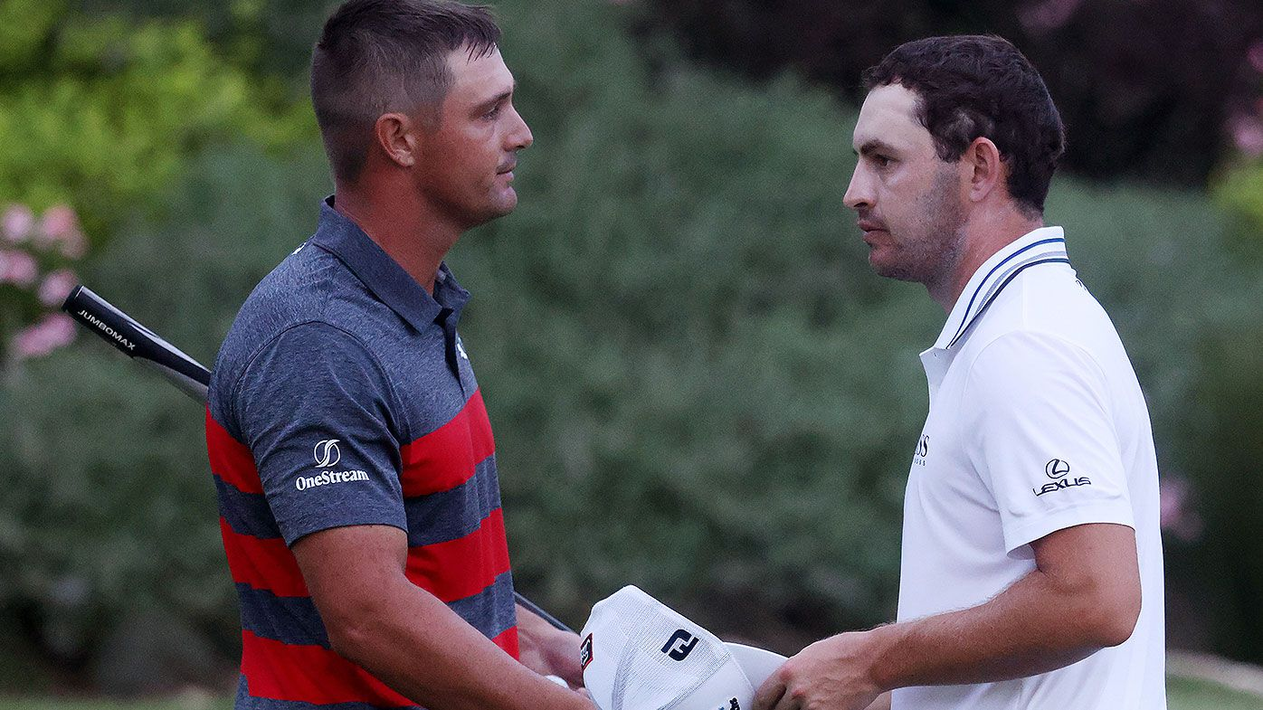 Bryson DeChambeau (L) of the United States congratulates Patrick Cantlay of the United States after Cantlay defeated DeChambeau on the sixth playoff hole during the final round of the BMW Championship at Caves Valley Golf Club on August 29, 2021 in Owings Mills, Maryland. (Photo by Rob Carr/Getty Images)