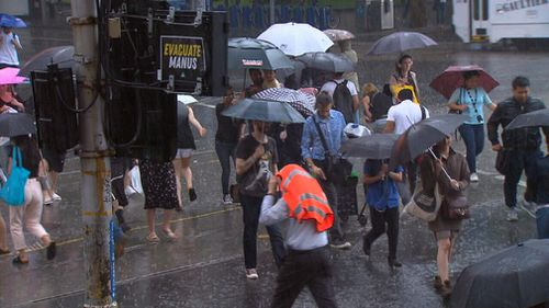 Tram lines were left submerged on Bourke Street and pedestrians battered as the storm returned with force yesterday afternoon. (9NEWS)