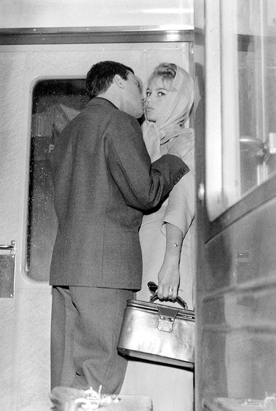 Jean Louis Trintignant stealing a kiss from Brigitte Bardot back in 1957.