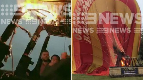Vision obtained by 9News shows the balloon, which was carrying 15 passengers, on fire.