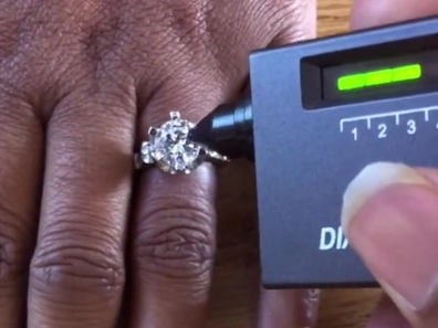 The students asked their teacher if they could test her ring.