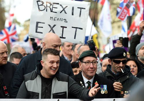 Far-right leader Tommy Robinson with UK Independence Party (UKIP) and pro Brexit supporters during UKIP Brexit betrayal march in London, England.