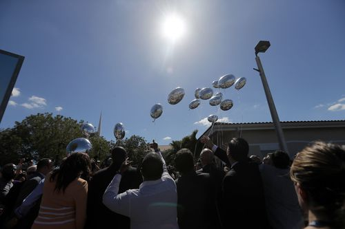 Seventeen balloons were released at the vigil last night. Picture: AAP
