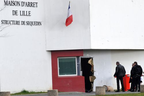 A view of the door opened with explosives by French prisoner Redoine Faid, who escaped from the Prison in Sequedin, near Lille, France (AAP)