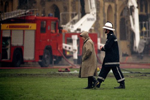 "The Queen, pictured at the scene on the day, was ""absolutely devastated"" by the blaze, her son the Duke of York said. Picture: Getty"