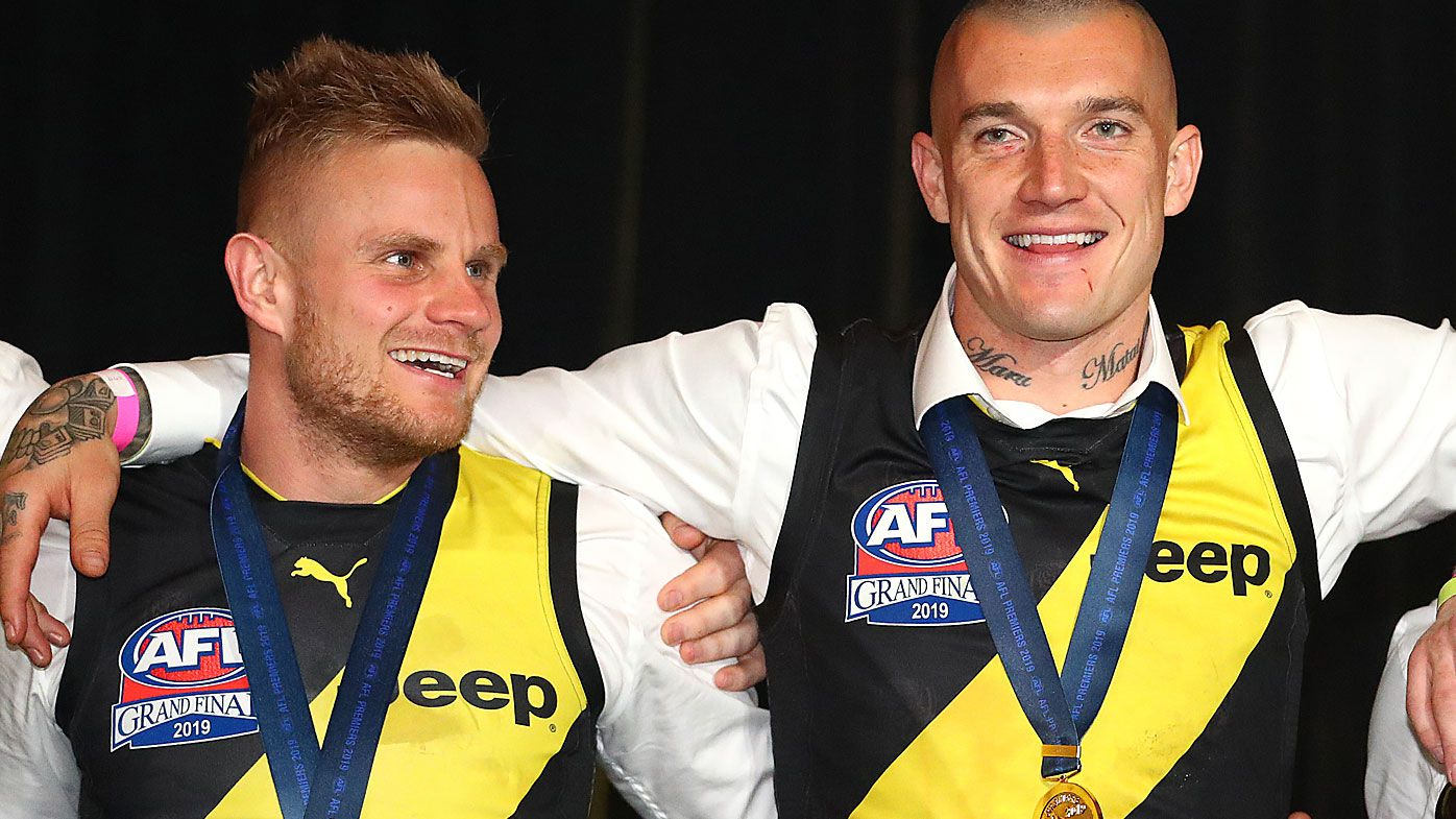Brandon Ellis of the Tigers with Dustin Martin