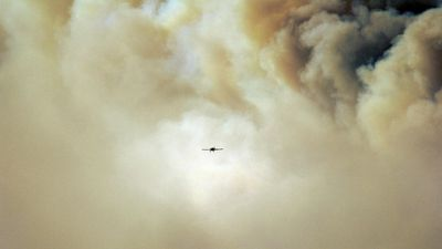 Firefighters are using water-bombing aircraft to try and battle the various blazes. (Supplied, Lily Brecht)