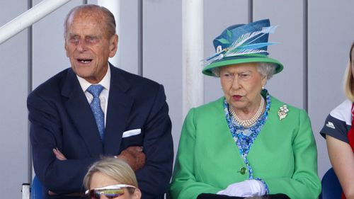 Prince Philip, Duke of Edinburgh and Queen Elizabeth II watch the England vs Wales women's hockey match at the Glasgow National Hockey Centre.