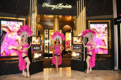 The front of a Honey Birdette store with three women standing in front of the door.