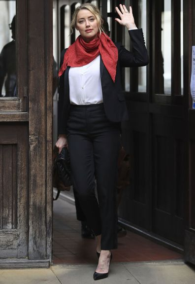Actress Amber Heard arrives at the High Court for a hearing in Johnny Depp's libel case, in London, Friday, July 24, 2020.