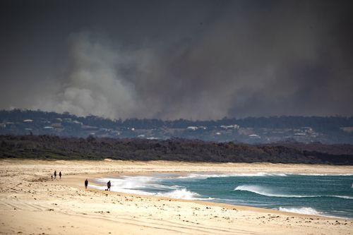 Smoke is seen in the distance near Tuncurry, NSW, November 9, 2019. (AAP Image/Shane Chalker) NO ARCHIVING