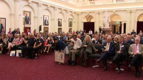 Dozens of people, including Victorian Health Minister Jill Hennessy, attended the special ceremony at Queens Hall. (9NEWS)