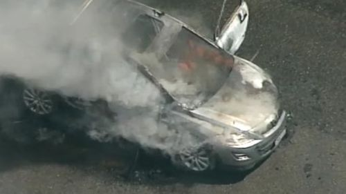 Two men have been taken to hospital with burns after a car fire in Yagoona. (9NEWS)