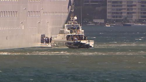 P&O Cruises' Pacific Explorer asked NSW Police Marine Area Command to escort the group from the ship. (9NEWS)