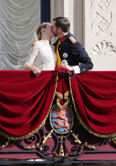 Princess Stephanie of Luxembourg and Prince Guillaume of Luxembourg kiss on the balcony of the Grand-Ducal Palace following the wedding ceremony of Prince Guillaume of Luxembourg and Stephanie de Lannoy at the Cathedral of our Lady of Luxembourg, in Luxembourg
