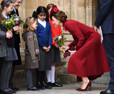 The Duchess of Cambridge greets children outside Westminster Abbey on March 9, 2020.