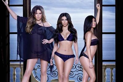 Is Kim Kardashian really this curvy? Fans cried foul upon seeing the photo of Kim with sisters Kourtney and Khloe promoting their underwear range, the Kardashian Kollection. Kim's waist looks unbelievably tiny, and Kourtney's waist looks suspiciously not-pregnant.