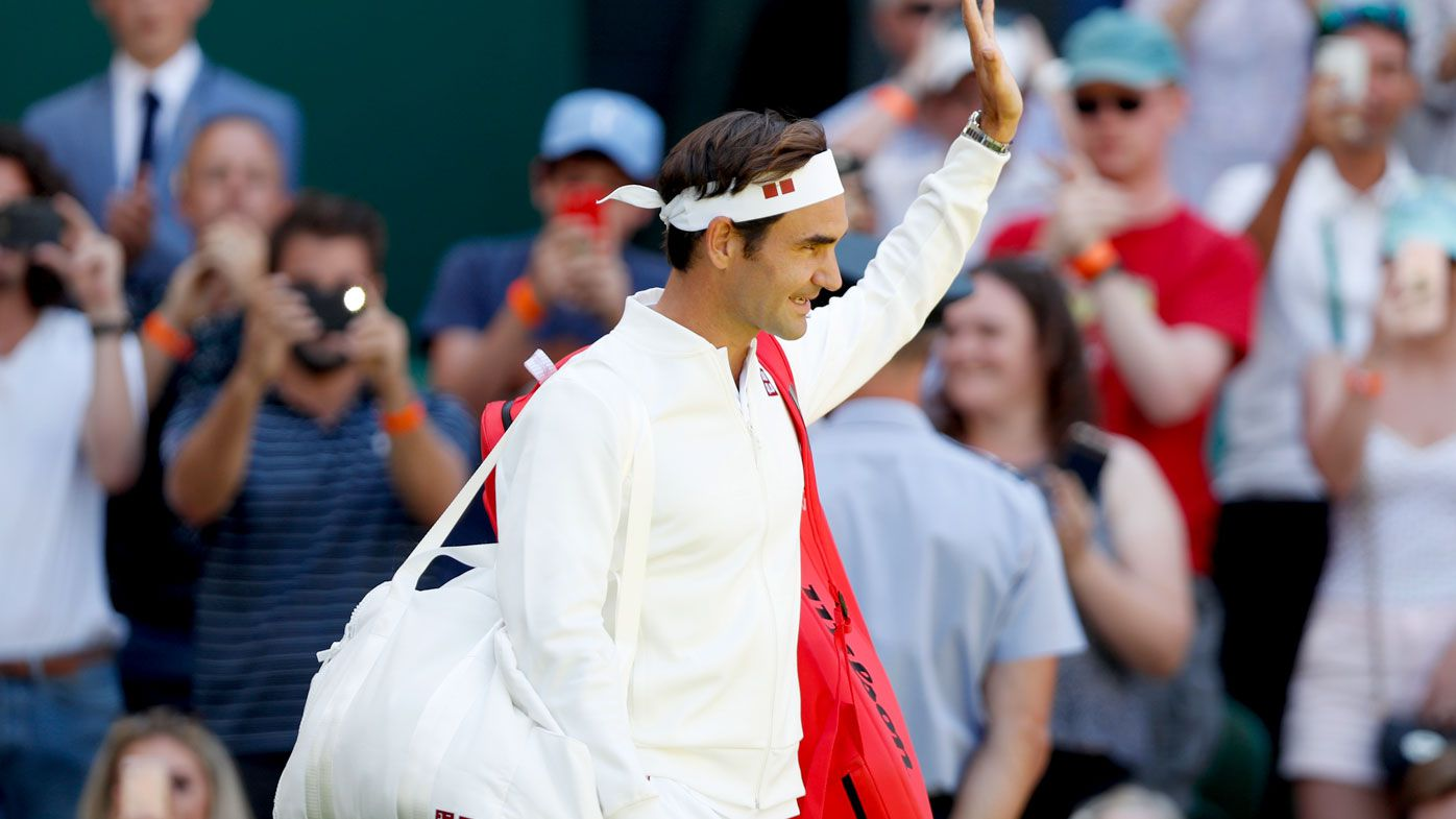 Roger Federer walks onto court at Wimbledon. (AAP)