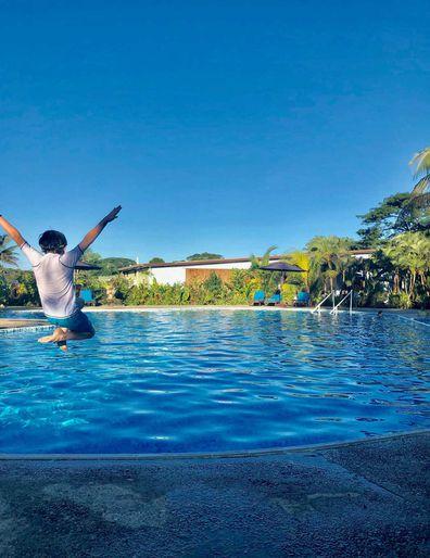 Kid jumping in Fiji resort pool