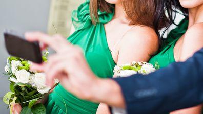 Bridal party taking selfie at wedding