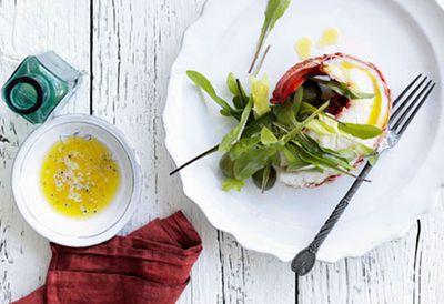 Lobster halves with lemon butter and dandelion leaf salad