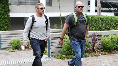 Cricketer Aaron Finch and Australian coach Darren Lehmann leave St Vincent's Hospital after visiting Phillip Hughes. (AAP)