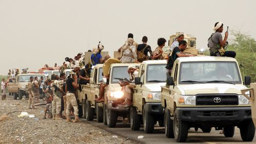 A column of Yemeni government forces and vehicles take position as they fight Houthi rebels in the western port city of Hodeidah.