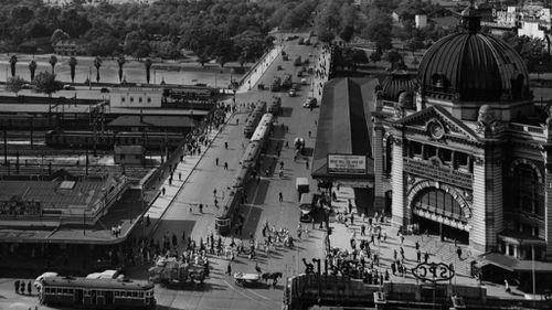 Flinders Street Station and Swanston Street in 1955. (Getty)