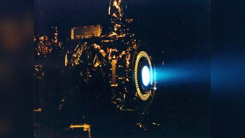 An example of an ion propulsion system during a hot fire test. (NASA/JPL)