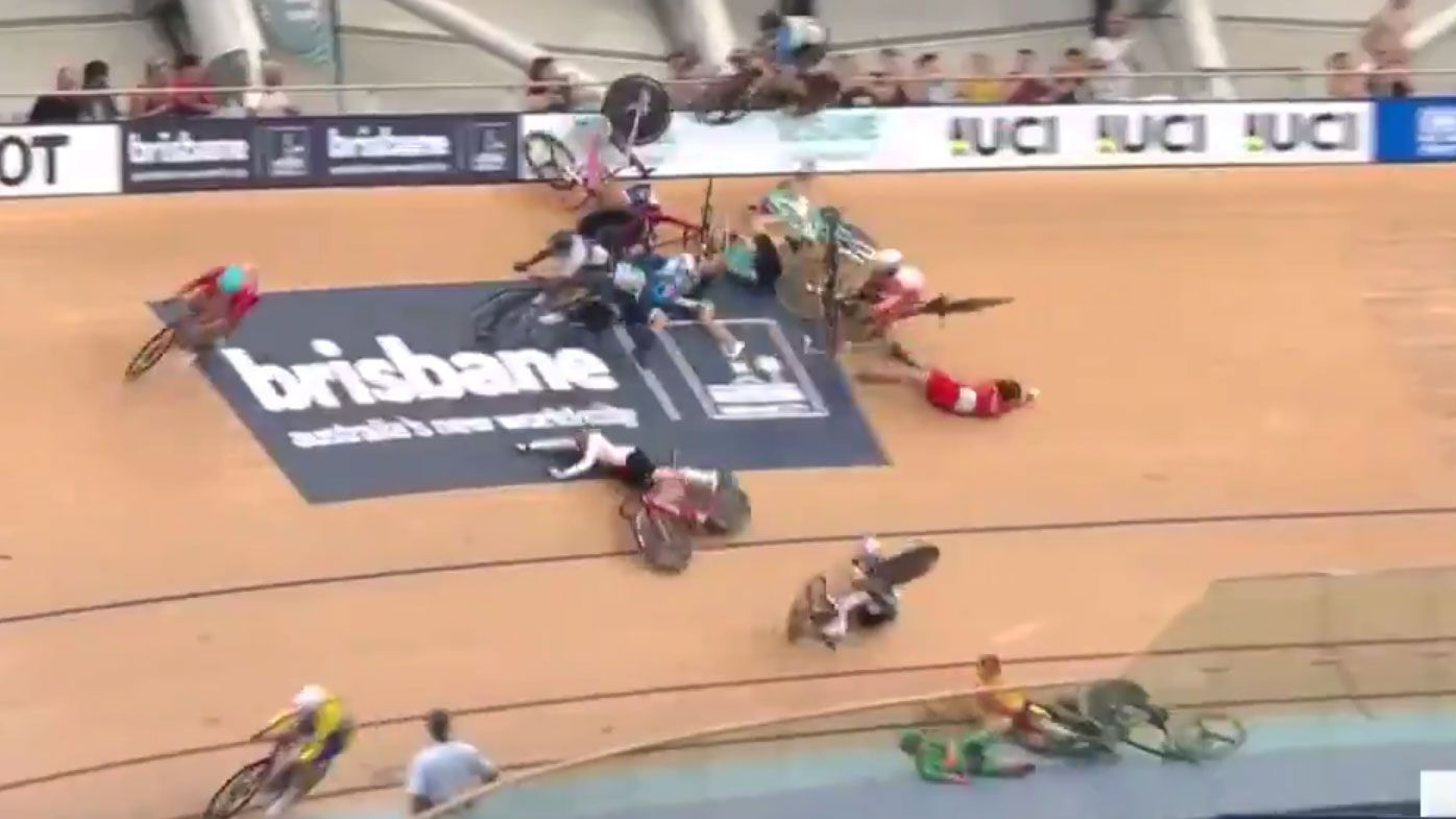 Riders fly through the air after crashing at the World Cup
