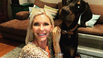 Devora Howard with her Doberman,
