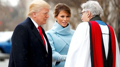 Reverend Luis Leon greets President-elect Donald Trump and his wife Melania as they arrive for a church service at St. John's Episcopal Church across from the White House. (AAP)