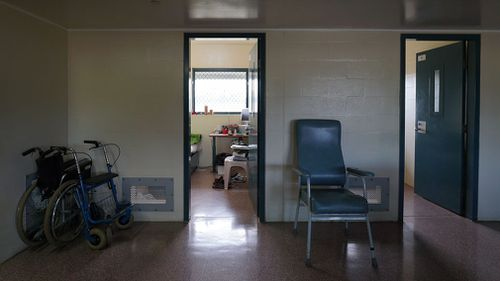 A wheelchair outside a room in Wolston Correctional Centre in Queensland. Many prisons are not fully accessible, making it extremely difficult for people with physical or sensory disabilities to navigate. (Image: AAP)