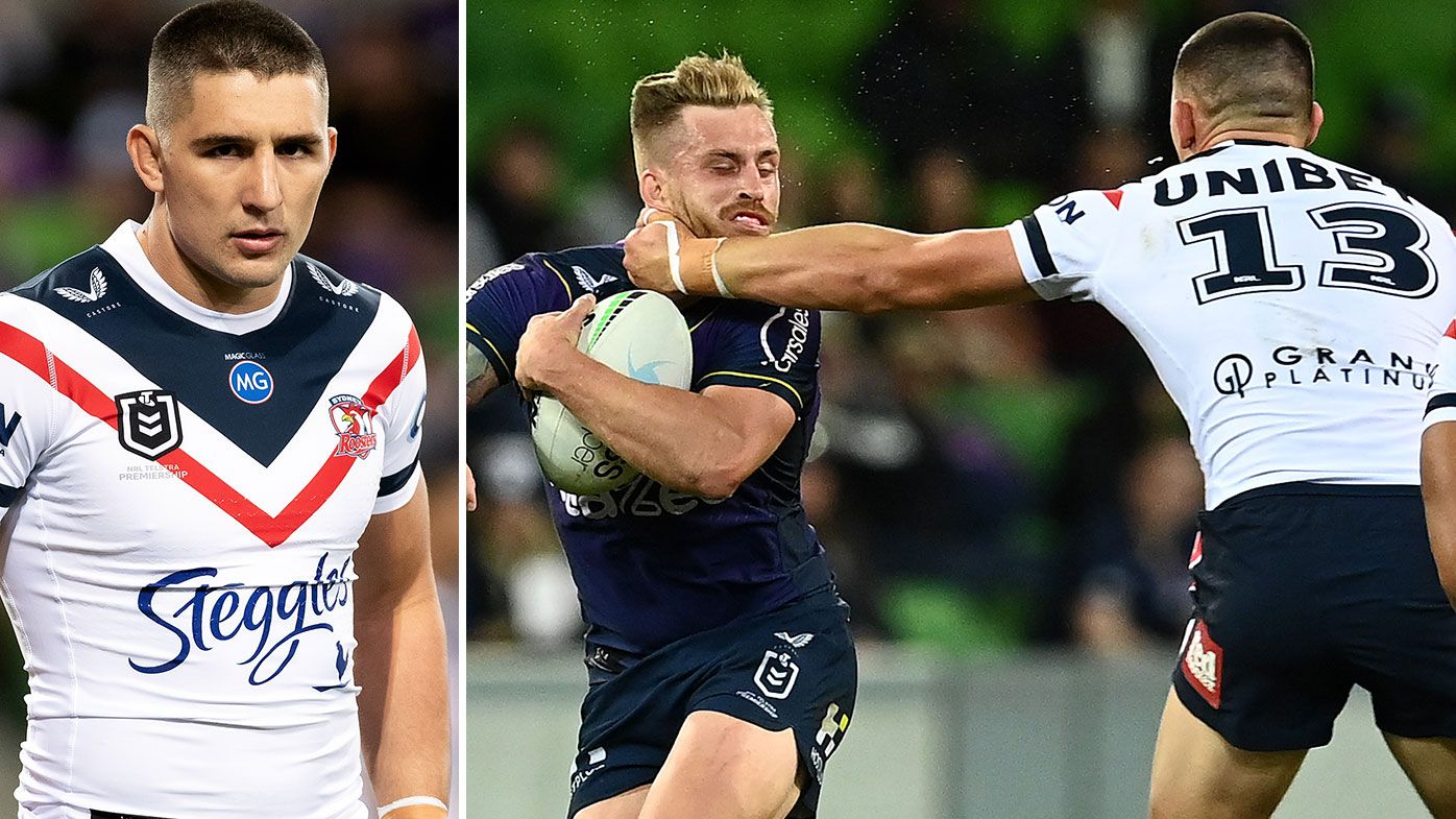 Cameron Munster of the Storm is tackled high by Victor Radley of the Roosters during the round six NRL match between the Melbourne Storm and the Sydney Roosters at AAMI Park on April 16, 2021, in Melbourne, Australia. (Photo by Quinn Rooney/Getty Images)