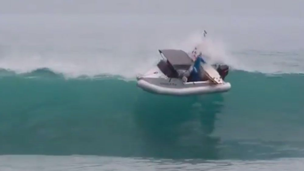 Surfer boat wipes out in comical fashion