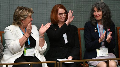 Former prime minister Julia Gillard listens to the apology.