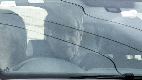 Cardinal George Pell seen inside the vehicle.