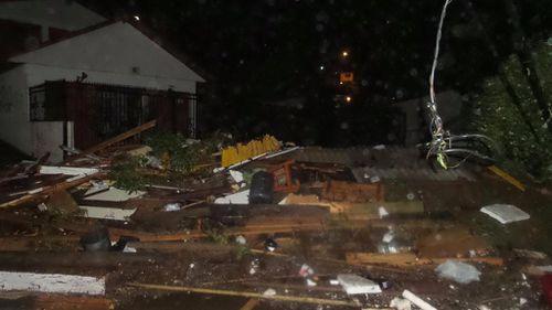 Debris lays in piles after a tsunami hit Los Vilos. (Citizen Corporation National Emergency Network)