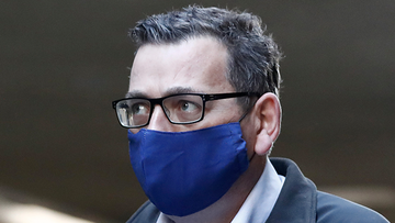 Victorian Premier Daniel Andrews wears a face mask as he walks in to the daily briefing on July 19, 2020 in Melbourne, Australia.