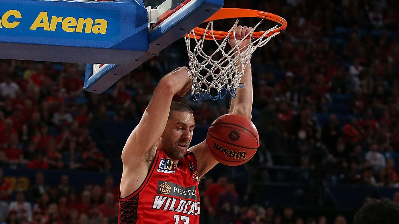 Tom Jervis dunks during the Wildcats win over the Hawks