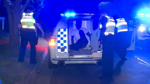 The accused was led into a police van following the incident.