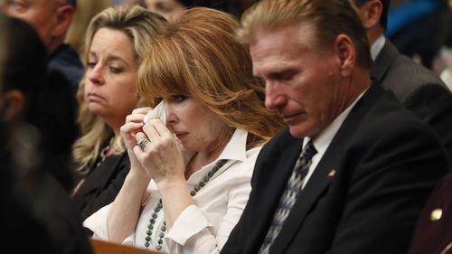 "Dani Jo Carter, center, a close friend of Diane McIver, reacts as reacts as Chief Assistant District Attorney Clint Rucker finishes his closing arguments during Claud ""Tex"" McIver's trial. (AAP)"