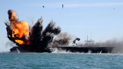 Iran has blown up a mock US aircraft carrier during its latest naval drill. Click through the gallery to see how the exercise unfolded. (AFP)